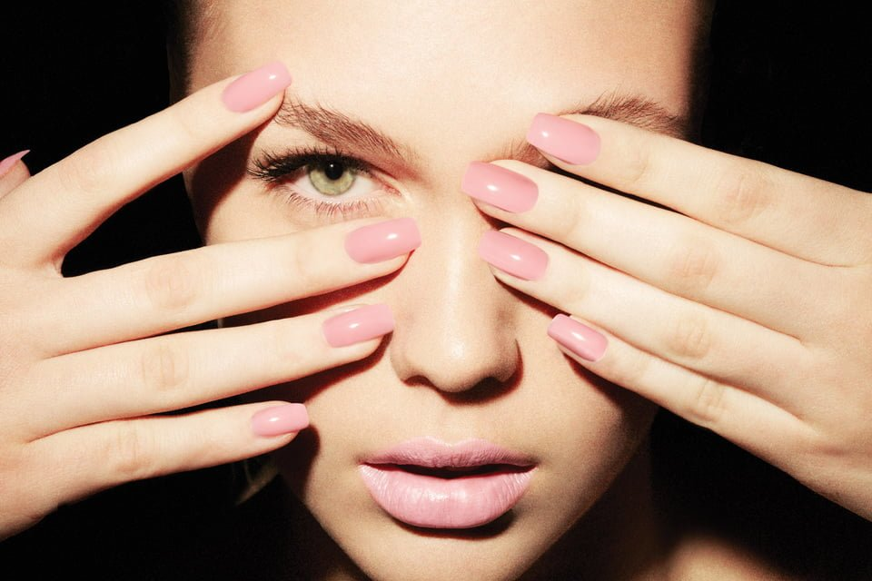 woman with pink nails
